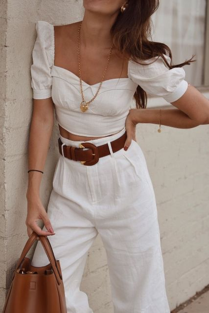 With white crop blouse, white wide leg pants and brown leather bag