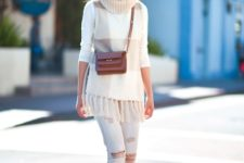 With white distressed pants, brown leather mini bag and pumps