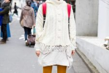With white dress, backpack, yellow tights and black lace up boots
