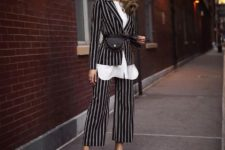 With white long shirt, black waist bag and black mules