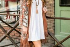 With white loose dress and gladiator sandals