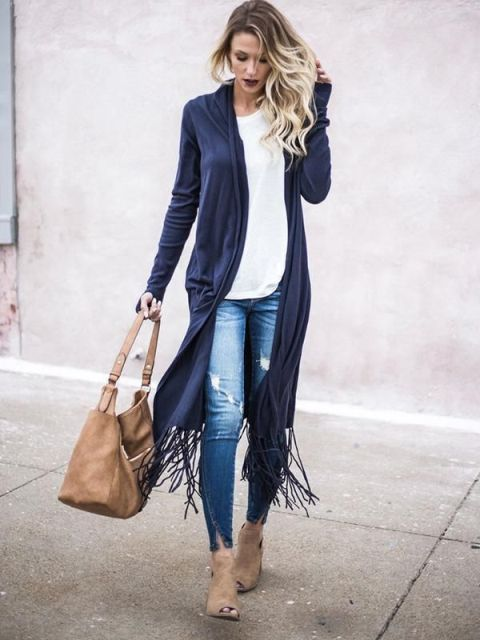 With white loose shirt, distressed jeans, beige bag and beige cutout boots