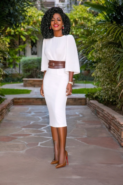 With white midi dress and brown pumps