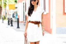With white mini dress, bag and flat sandals