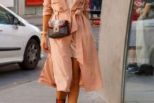With white mini dress, peach trench coat and crossbody bag