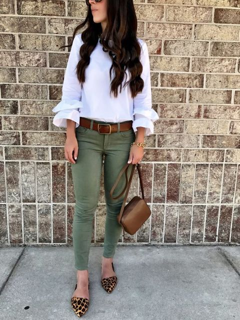 With white ruffled blouse, olive green trousers, leopard flat shoes and brown small bag