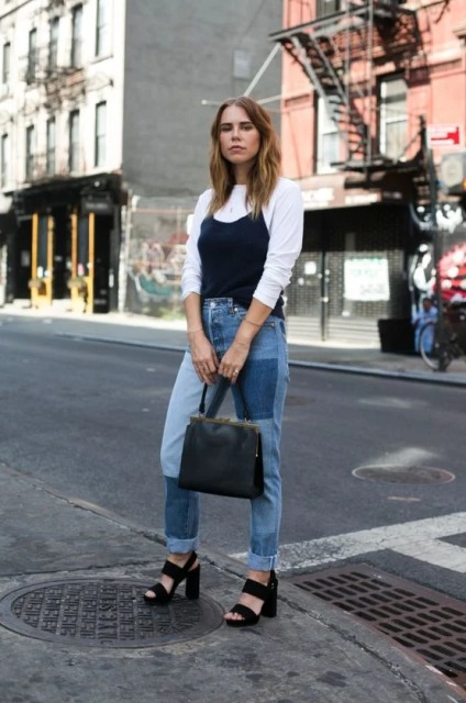 With white shirt, black top, black leather bag and black sandals