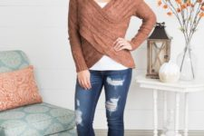 With white shirt, distressed jeans and brown suede cutout boots