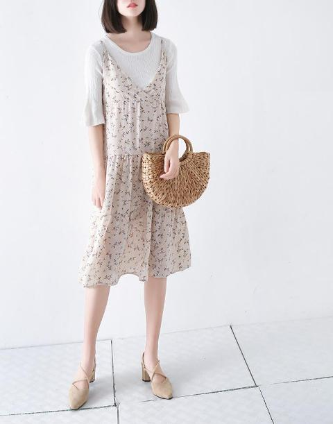 With white shirt, floral dress and beige shoes