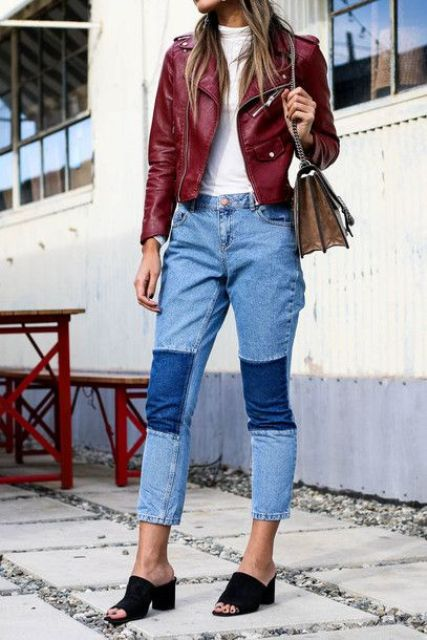 With white shirt, marsala leather jacket, bag and black mules