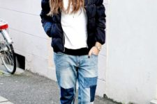 With white shirt, navy blue puffer jacket and sneakers