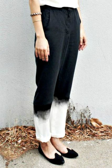 With white t-shirt and black flat shoes