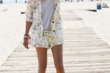 With white t-shirt and white flat sandals