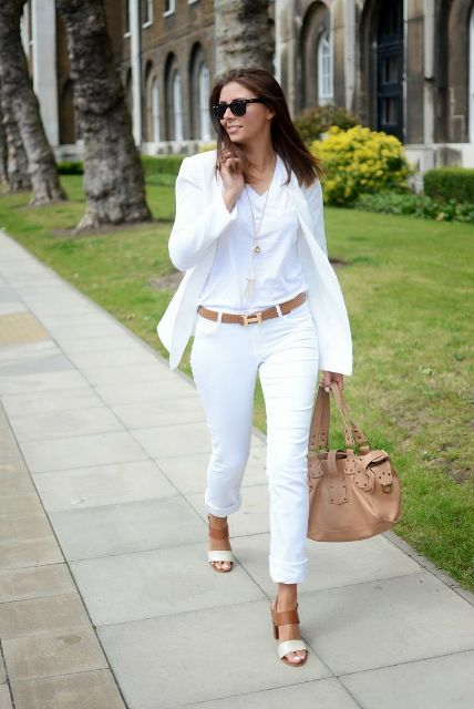 With white t-shirt, blazer, cuffed pants, beige bag and white and brown sandals