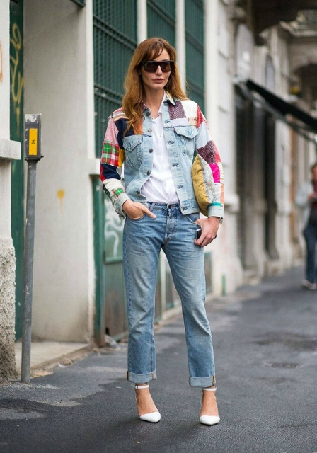 With white t-shirt, cuffed jeans, clutch and white ankle strap shoes