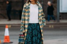 With white t-shirt, plaid bag, white ankle boots and printed midi skirt