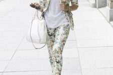 With white t-shirt, white tote bag and yellow sandals