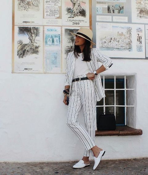 With white t-shirt, wide brim hat, black belt and white mules