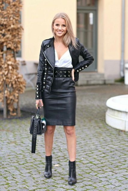 With white top, black leather jacket, black bag and black ankle boots