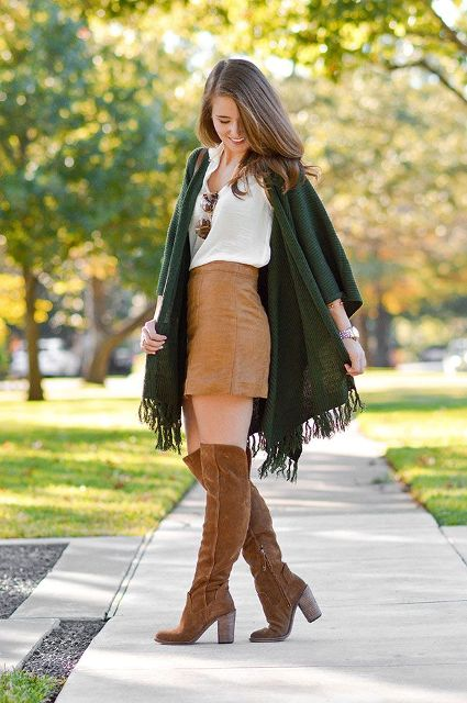 With white top, brown mini skirt and brown suede boots