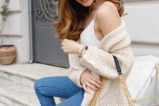 With white top, cardigan, printed bag and cropped jeans