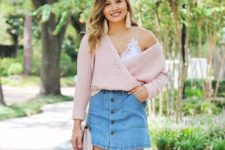 With white top, denim skirt and beige bag
