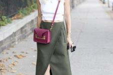 With white top, olive green wrapped maxi skirt and purple crossbody bag