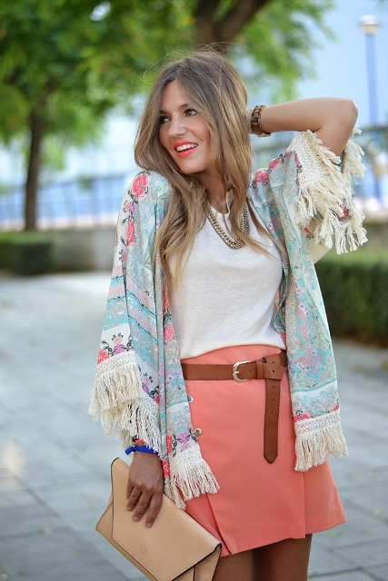 With white top, pink skirt, brown belt and beige clutch