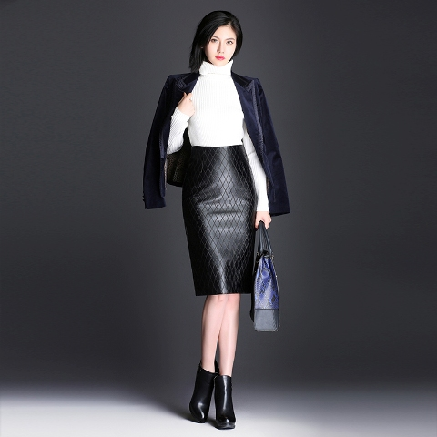 With white turtleneck, black blazer, bag and ankle boots