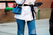 With white wrapped blouse, black belt, blue crossbody bag and flat shoes