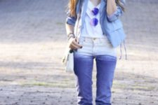 With wide brim hat, white bag, white top, blue jacket and white heels