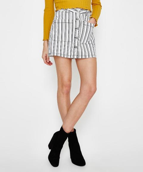 With yellow shirt and black ankle boots