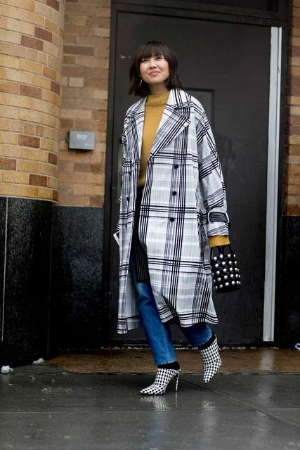 With yellow shirt, jeans, embellished bag and checked mules