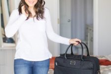 a black travel bag like this one allows to put a lot inside and will fit most of your outfits