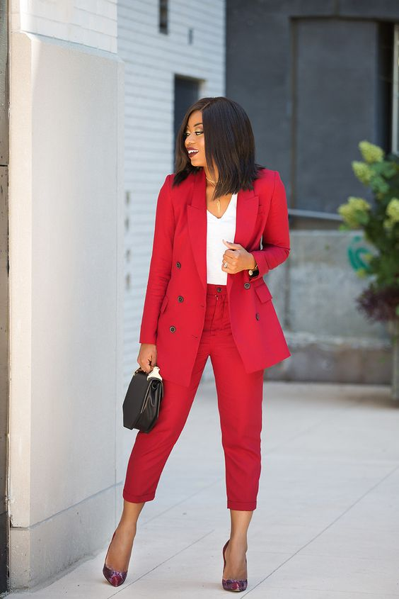 a bright red pantsuit, a white top, colorful pumps and a black geometric bag for an ultimate office look
