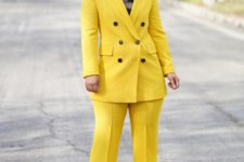 a bright yellow pantsuit, a black printed top and statement sunglasses will make you look jaw-dropping