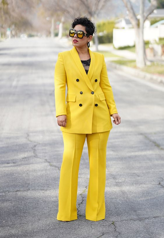 a bright yellow pantsuit, a black printed top and statement sunglasses will make you look jaw dropping
