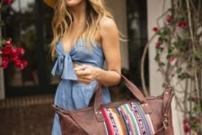 a brown leather bag with colorful appliques for a slightly tribal and wild-spirited style