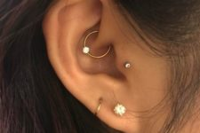 a chic setup with rhinestones and hoops including a rhinestone hoop in the daith