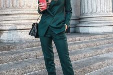 a dark gree pantsuit, a nude turtleneck and white sneakers for a bright fall work look