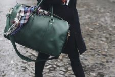 a dark green weekender bag will add a touch of color and will make your look cooler