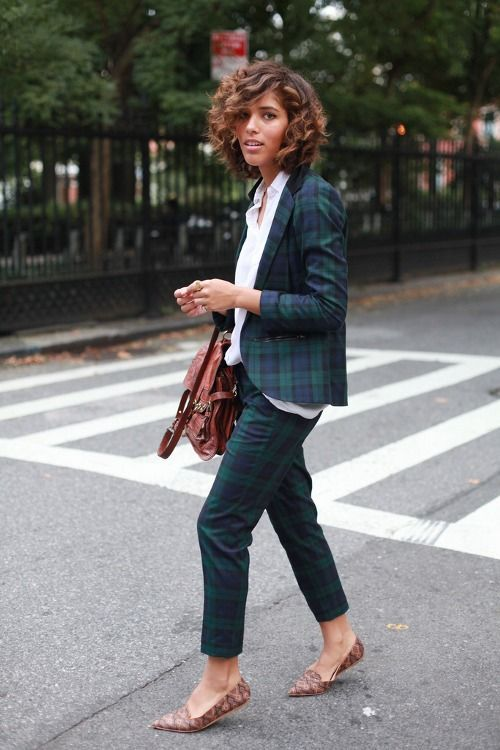 a dark plaid pantsuit, a white shirt to refresh the look, snake print loafers and a brown bag