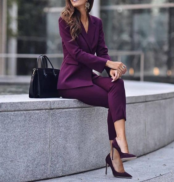 a monochromatic purple pantsuit, matching velvet pumps and a black bag to make a bold statement