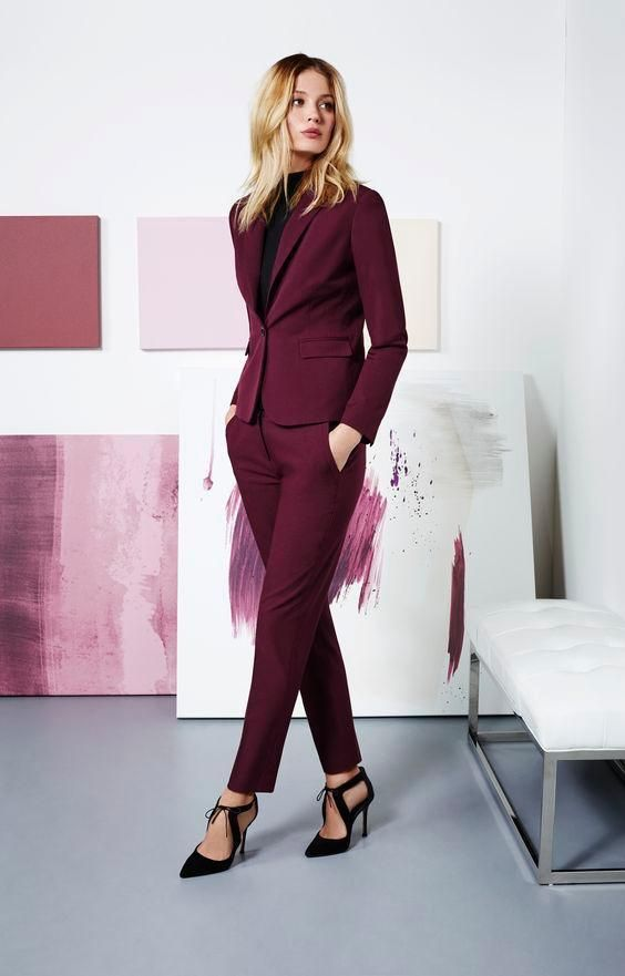 a purple pantsuit, a black turtleneck and chic black cutout heels for a sexy business outfit