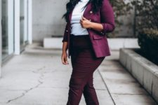 a purple pantsuit, a white turtleneck and nude pumps for a chic and bold work outfit