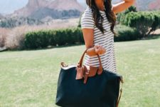 a simple black and brown weekender bag is ideal for travelling and for spending weekends somewhere