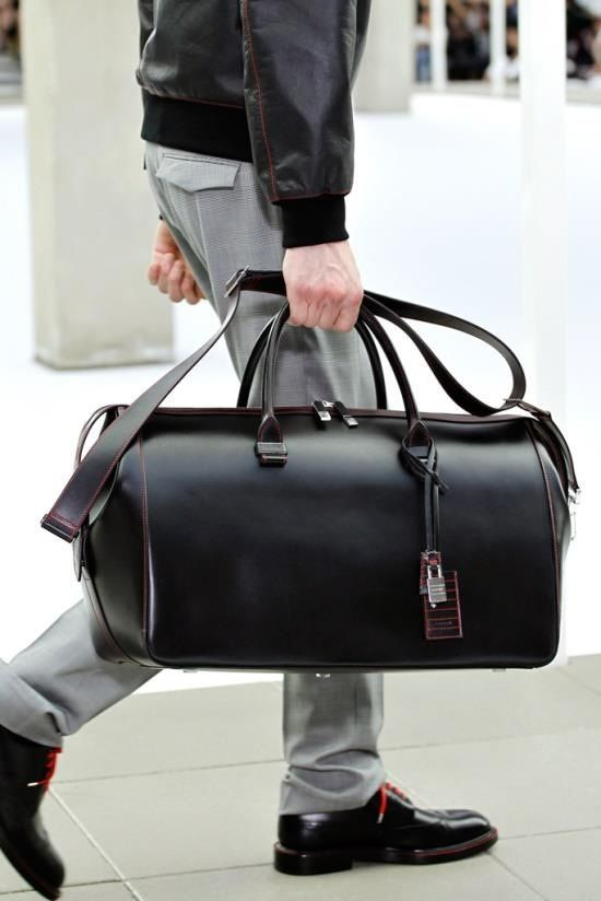 a sleek black leather travel bag with touches of pink is an ultra-modern idea with plenty of style