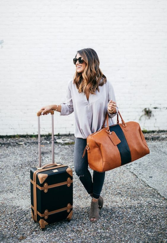 a stylish amber and navy weekender leather bag is a chic idea for travelling and going somewhere