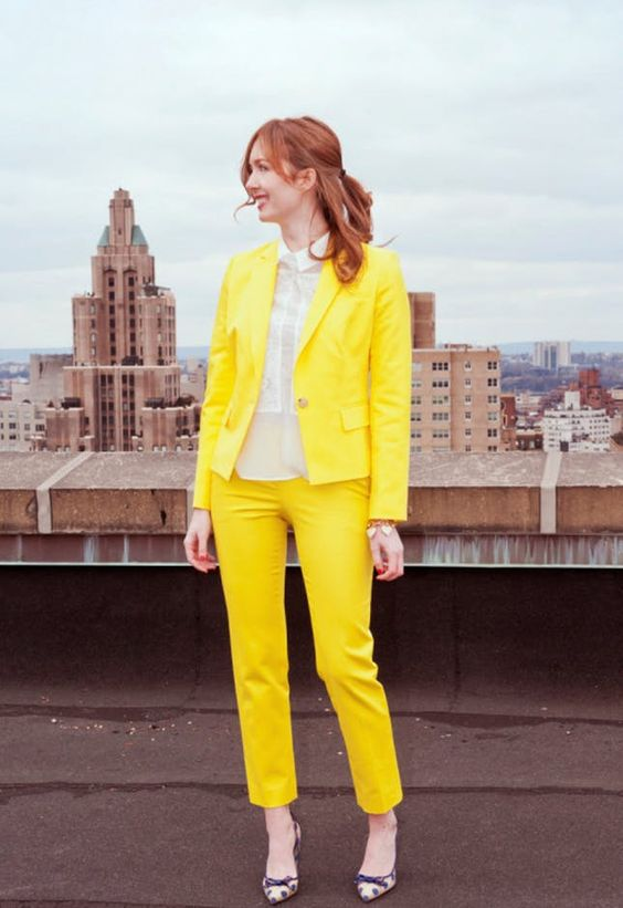 a sunny yellow pantsuit, a neutral shirt and polka dot shoes will raise your mood at once