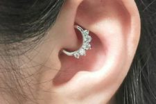 only daith piercing done with a shiny rhinestone hoop is a stylish and bold idea
